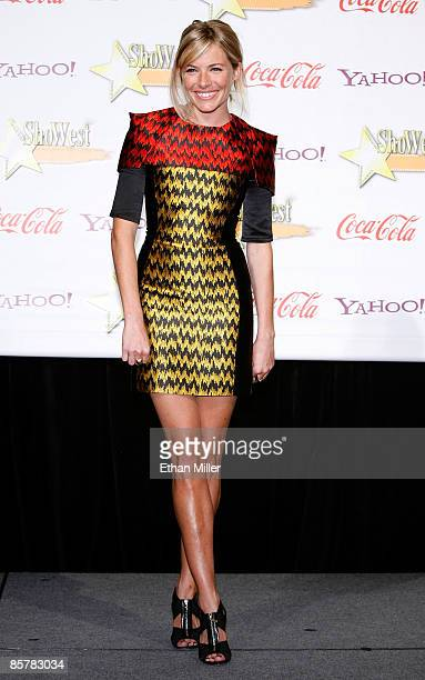 Actress Sienna Miller recipient of the Supporting Actress of the Year Award arrives at the ShoWest awards ceremony at the Paris Las Vegas during...