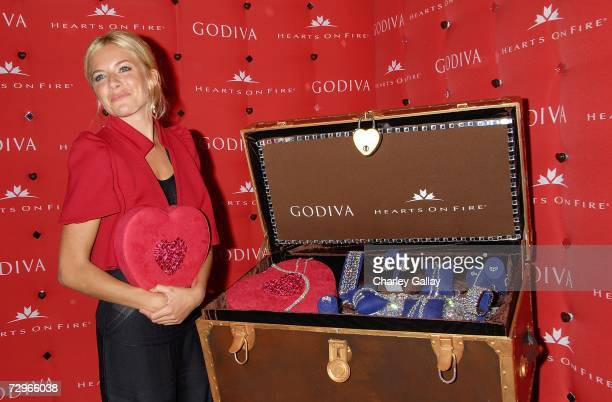 Actress Sienna Miller unveils the Godiva OneMillion Dollar Hearts on Fire Shopping Spree Valentine's Day Offer at the Godiva Boutique in the Century...