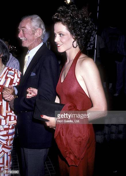 Actress Sigourney Weaver and father Sylvester 'Pat' Weaver attend the 'Aliens' Westwood Premiere on July 14 1986 at Avco Centre Cinemas in Westwood...