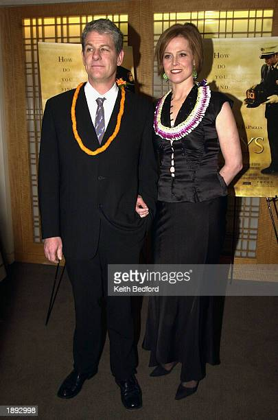 Actress Sigourney Weaver and her husband director Jim Simpson arrive at the premiere of the film The Guys April 2 2003 in New York City