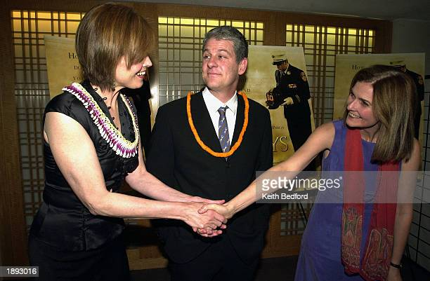 Actress Sigourney Weaver and her husband director Jim Simpson greet playwright Anne Nelson at the premiere of the film The Guys April 2 2003 in New...