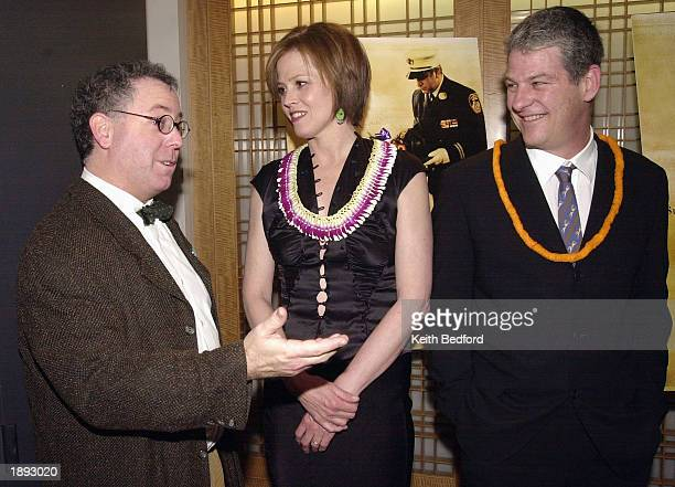 Actress Sigourney Weaver and her husband director Jim Simpson greet Focus Features president James Schamus at the premiere of the film The Guys April...