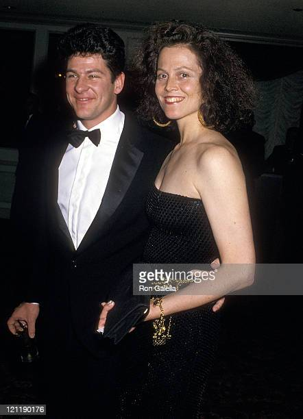 Actress Sigourney Weaver and husband Jim Simpson attend the American Academy of Dramatic Arts Honors Hume Cronyn and Jessica Tandy on May 1 1988 at...