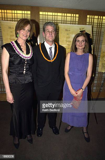 Actress Sigourney Weaver her husband director Jim Simpson and playwright Anne Nelson arrive at the premiere of the film The Guys April 2 2003 in New...
