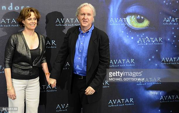 US actress Sigourney Weaver poses next to Canadian film director James Cameron during a photocall for their latest movie 'Avatar' on December 8 2009...