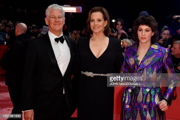 US actress Sigourney Weaver poses with her husband Jim Simpson and their daughter Charlotte Simpson on the red carpet before the opening ceremony of...