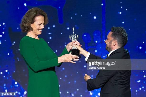 Actress Sigourney Weaver receives the Donostia award from director Juan Antonio Bayona during the 64th San Sebastian International Film Festival at...
