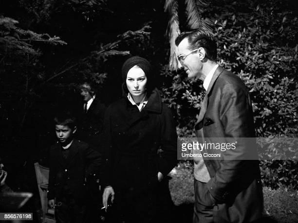 Actress Silvana Mangano with film director Carlo Lizzani during the shooting of the movie 'Processo di Verona' Silvana Mangano wears a turban like...