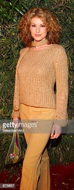 Actress Simmone Jade Mackinnon arrives at the Fashion For Freedom fashion show December 6 2001 in Los Angeles CA