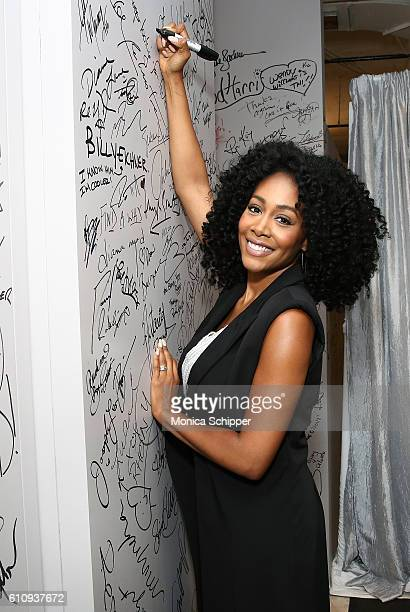 Actress Simone Missick signs the wall at AOL HQ when she visits for BUILD Speaker Series Presents Simone Missick Discussing Marvel's Luke Cage at AOL...