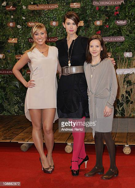 Actress Sina Tkotsch writer Sabine Kuegler and young actress Stella Kunkat attend the 'Dschungelkind' Premiere at CineStar on February 7 2011 in...