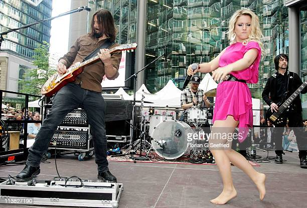 Actress singer Jeanette Biedermann and Joerg Weisselberg perform at the Fan Event of 'Anna Und Die Liebe' and 'Hand aufs Herz' at Sony Centre on May...