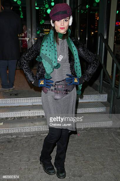 Actress / singer Melissa Mars is seen wearing a boutique hat and earmuffs vintage scarf Quentin Veron jacket Amalia Mattaor dress a Chanel necklace...