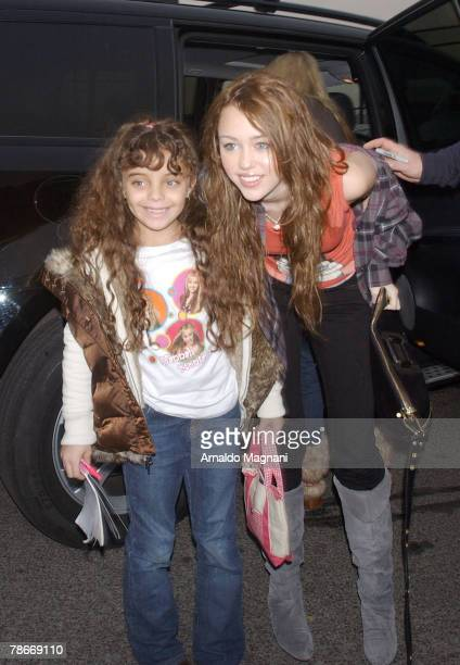 Actress singer Miley Cyrus poses at a heliport to take her to her performance at the Nassau Coliseum December 28 2007 in New York City
