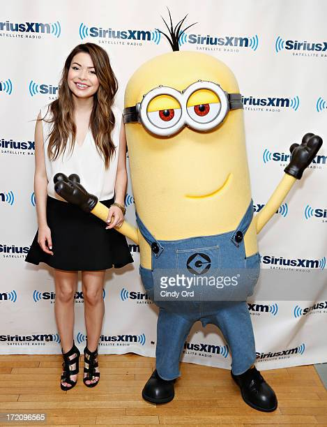 Actress/ singer Miranda Cosgrove and Tim the Minion visit the SiriusXM Studios on July 1 2013 in New York City