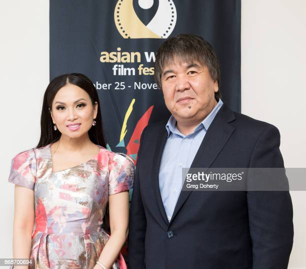 Actress Singer Philanthropist Ha Phuong Cha Tran and AWFF Founder Chairman Sadyk SherNiyaz attend a reception as Angelina Jolie Accepts the Rising...