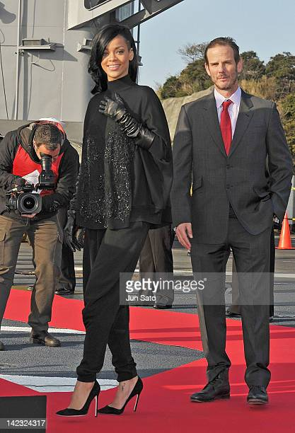 Actress/ singer Rihanna and director Peter Burg attend the 'Battleship' Press Conference on the USS George Washington at U.S. Fleet Activities...