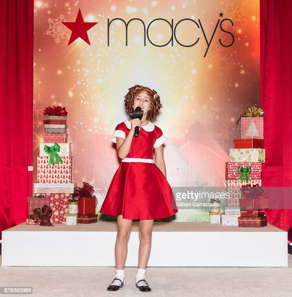 Actress singer Tahlia Ellie from the Broadway musical Annie performs during Macy's Center City Celebrates Its Annual Holiday Window Unveiling And...
