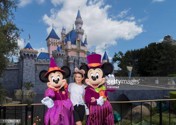 Actress singersongwriter and author Lea Michele celebrates Halloween Time with Minnie Mouse and Mickey Mouse at Disneyland Park in Anaheim Calif on...