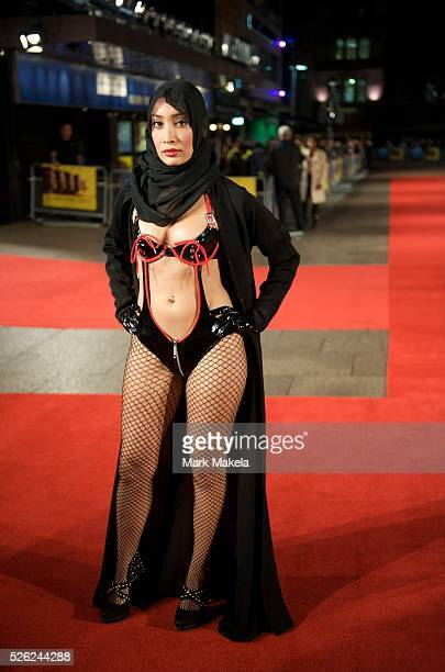 Actress Sofia Hayat bedecked in a hijab disrobes into a dominatrix costume for a performance piece alerting others to the oppression many Muslim...