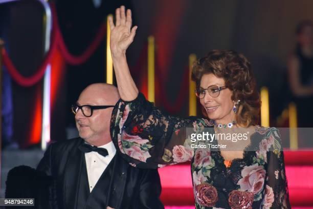 Actress Sofia Loren and fashion designer Domenico Dolce attend the Dolce Gabbana Alta Moda and Alta Sartoria collections fashion show at Soumaya...