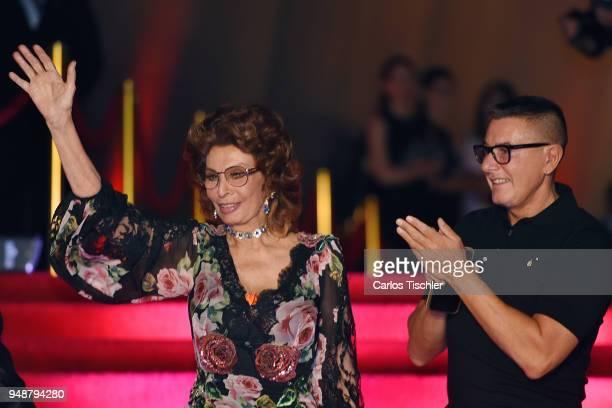 Actress Sofia Loren and fashion designer Stefano Gabbana gesture prior the Dolce Gabbana Alta Moda and Alta Sartoria collections fashion show at...