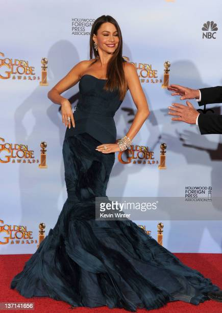 Actress Sofia Vergara poses in the press room with the Best Television Series - Musical or Comedy award for 'Modern Family' at the 69th Annual Golden...