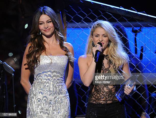Actress Sofia Vergara presents singer Shakira with the Person of the Year Award onstage during the 12th annual Latin GRAMMY Awards at the Mandalay...