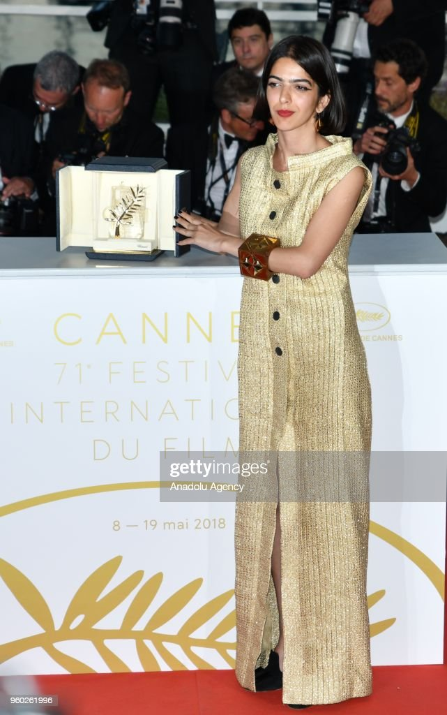 Actress Solmaz Panahi, daughter of Jafar Panahi, poses with the Best Screenplay prize for the film '3 Faces (Se Rokh) at the 71st Cannes Film Festival in Cannes, France on May 19, 2018.