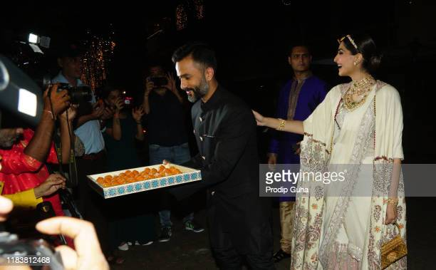 Actress Sonam Kapoor and her husband Anand Ahuja attend the meet with Media and distributedsweets for Diwali Celebration on October 27 2019 in...