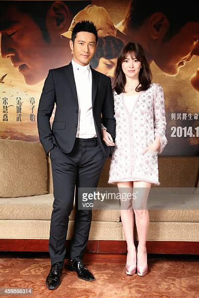 Actress Song Hyegyo and actor Huang Xiaoming take photo shoots during their promotion new film The Crossing on December 2 2014 in Taipei Taiwan of...