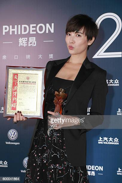 Actress Song Jia poses during the 20th Huading Awards and China Film Satisfaction Survey Release Ceremony at Kowloon Bay International Trade...