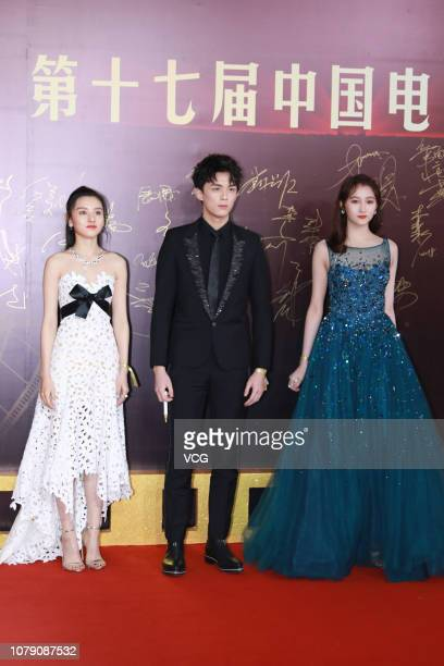 Actress Song Zuer actor Wu Lei and actress Guan Xiaotong pose on the red carpet of the 17th China Huabiao Film Awards Ceremony on December 8 2018 in...