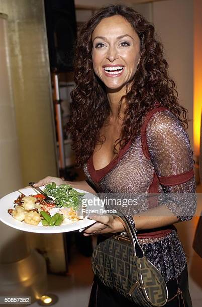 Actress Sonia Milos showing off her plate of food at the afterparty for the Los Angeles premiere of Stateside on May 18 2004 at The Crest Theatre in...