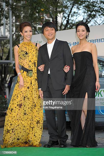 Actress Sonia Sui Director Lien Yichi and actress Nikki Hshie pose on the green carpet during the Tokyo International Film Festival Opening Ceremony...