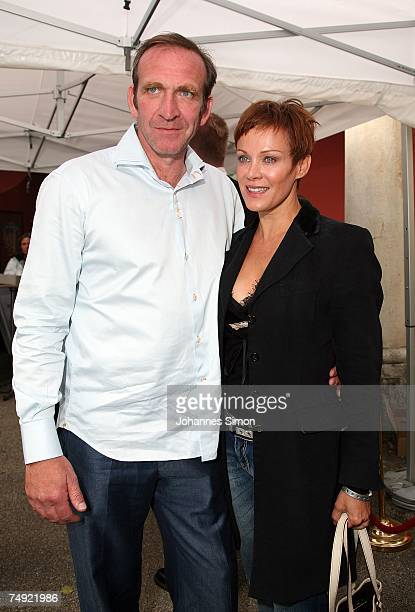 Actress Sonja Kirchberger and boyfriend Jochen Nickel pose during a reception of the Bavaria film company on June 26 in Munich Germany