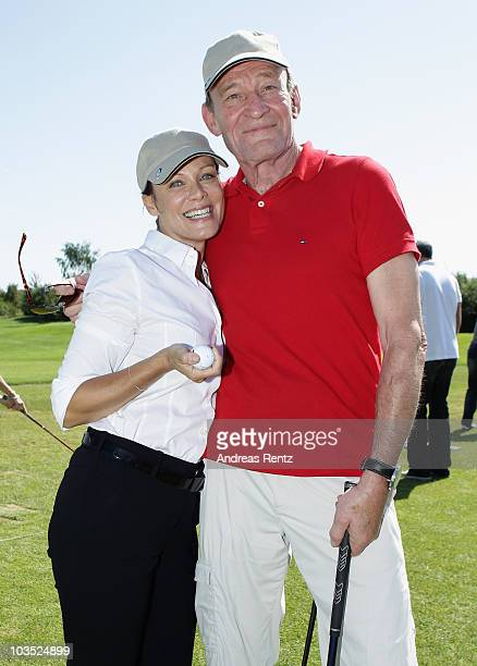 Actress Sonja Kirchberger and Michael Mendl attend the BMW Adlon Golf Cup 2010 at Golf and Country Club Seddiner See on August 21, 2010 in Michendorf...