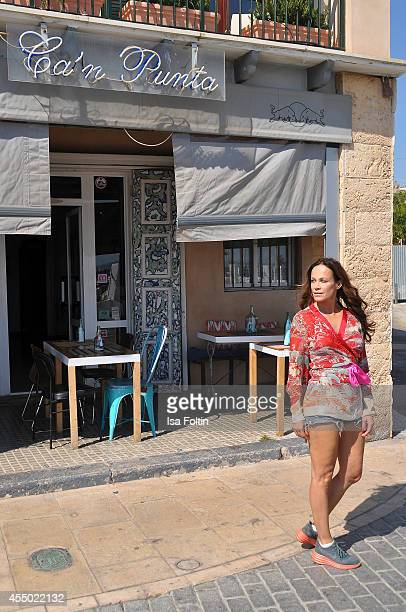 Actress Sonja Kirchberger poses in front of her restaurant Ca'n Punta on September 6 2014 in the harbour of Molinar near Palma de Mallorca Spain