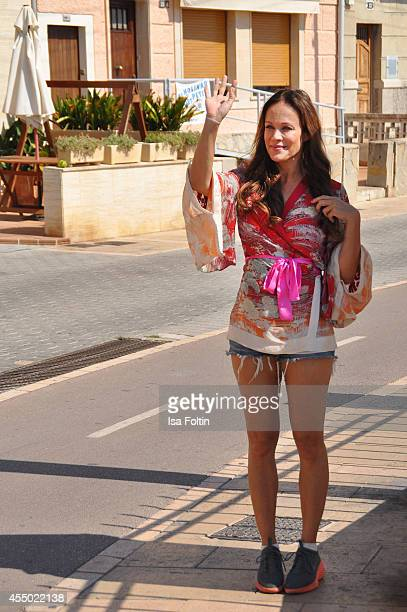 Actress Sonja Kirchberger waves near her restaurant Ca'n Punta on September 6 2014 in the harbour of Molinar near Palma de Mallorca Spain
