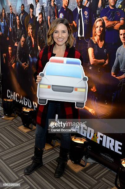 Actress Sophia Bush holding a police car cutout attends a press junket for NBC's 'Chicago Fire' 'Chicago PD' and 'Chicago Med' at Cinespace Chicago...
