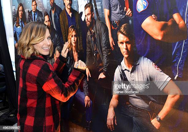 Actress Sophia Bush signs a poster as she attends a press junket for NBC's 'Chicago Fire' 'Chicago PD' and 'Chicago Med' at Cinespace Chicago Film...