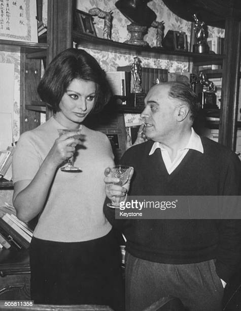 Actress Sophia Loren and her husband film producer Carlo Ponti sharing a drink in their home after hearing the news that she had won an Academy Award...