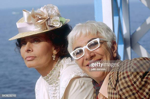 Actress Sophia Loren poses in costume with director Lina Wertmuller on the set of Wertmuller's 1990 Italian film Sabato Domenica e Lunedi The film...