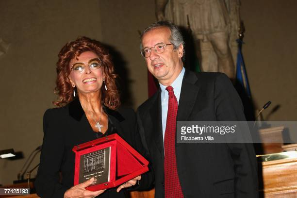 Actress Sophia Loren poses with the Mayor of Rome Walter Veltroni andher lifetime achievement award Il Campidoglio from the city of Rome during day 3...