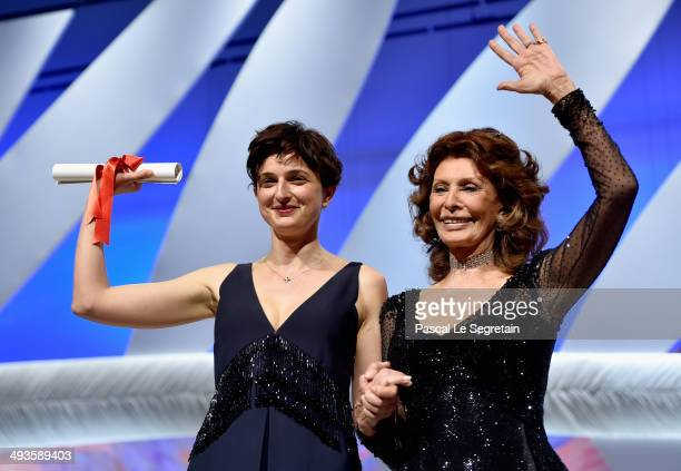 Actress Sophia Loren presents on stage The Grand Prix award to director Alice Rohrwacher during the Closing Ceremony at the 67th Annual Cannes Film...