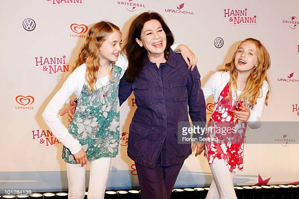 Actress Sophia Muenster and twinsister actress Jana Muenster and actress Hannelore Elsner attend the 'Hanni Nanni World Premiere' at Mathaeser cinema...