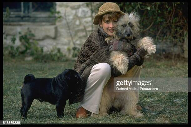 Actress Sophie Marceau at Home with Her Dogs