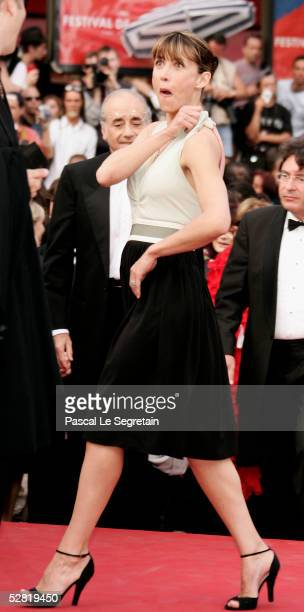 Actress Sophie Marceau has an embarrassing moment as her top falls down while she enters a screening of Where the Truth Lies at the Grand Theatre...