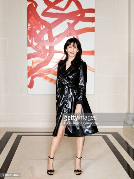 Actress Sophie Marceau is photographed for Madame Figaro on February 6, 2018 in Paris, France. Trench coat by The Kooples. Photographed in front of...
