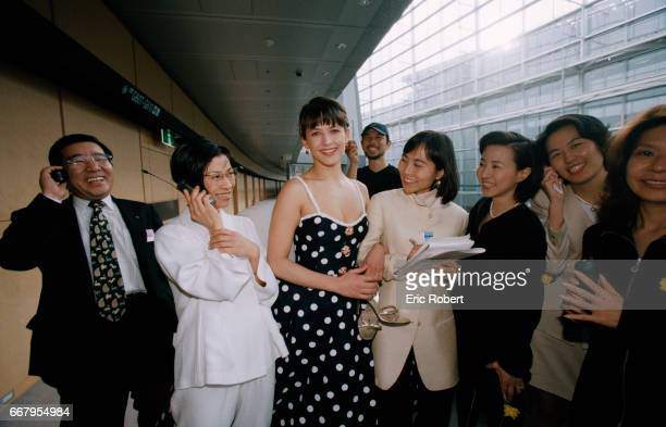 Actress Sophie Marceau is surrounded by the Japanese staff the French perfume house Guerlain while in Tokyo to promote a new perfume Champs Elysses